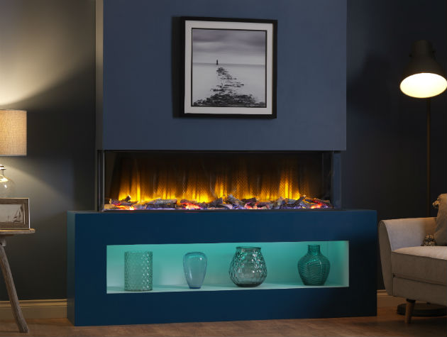 modern fireplace with electric wood effect fire vases and blue led lighting