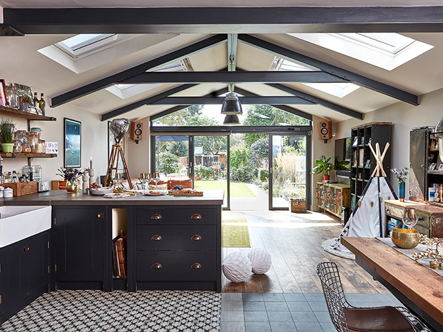 Kloeber Aluminium Bifolds in contemporary kitchen with exposed roof gables - grand designs