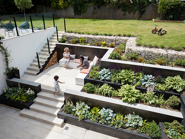 garden on a gradient with stairs and planters - home improvements - grand designs