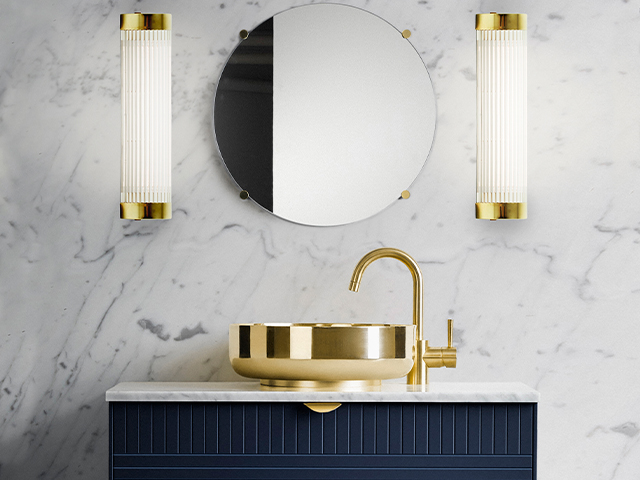 gold wall lights - what to consider when planning a bathroom renovation - home improvements - granddesignsmagazine.com