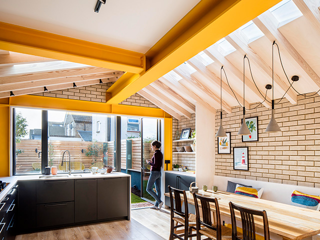 kitchen extension with yellow structural exposed beams