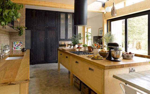 Open-plan country kitchen with timber work surfaces