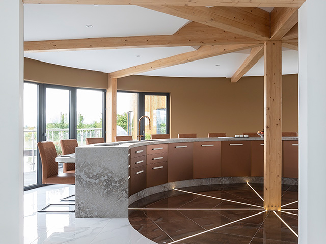Looking through the doorway into the semi-circular kitchen - Grand Designs kitchens