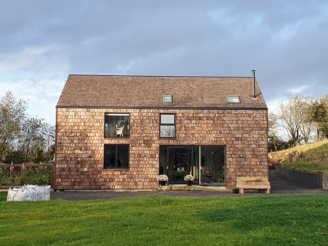 Self build home with wooden shingle cladding - grand designs