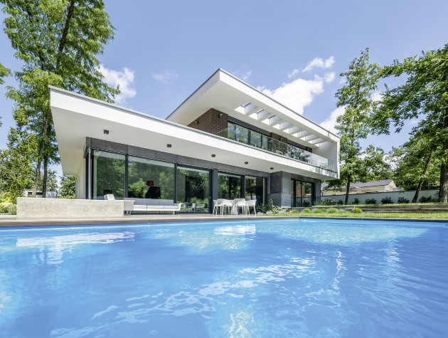 swimming pool in front of modern design house