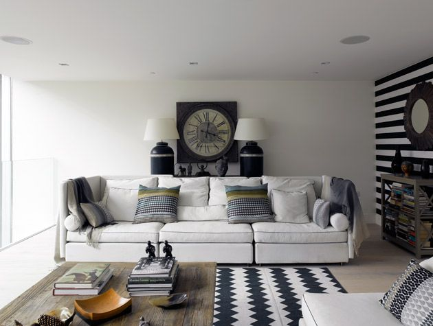 Inside the Grand Designs water tower in Kennington, with monochrome living room decor