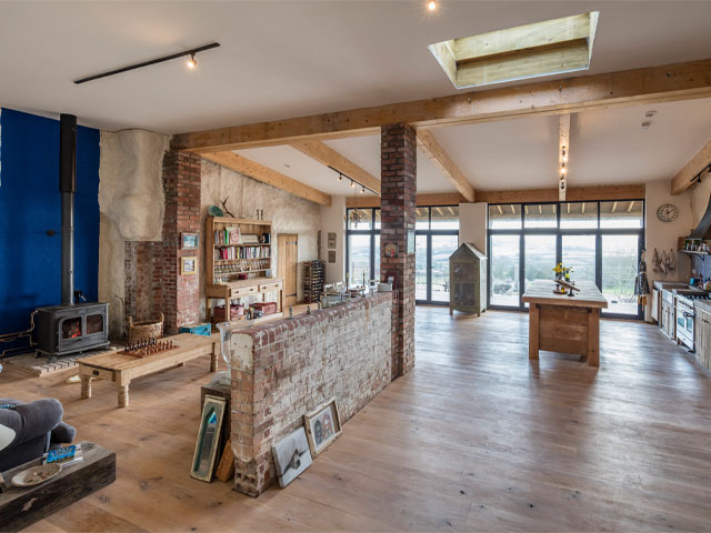 Inside the huge open plan living/dining space of the Grand Designs cowshed property conversion in Somerset