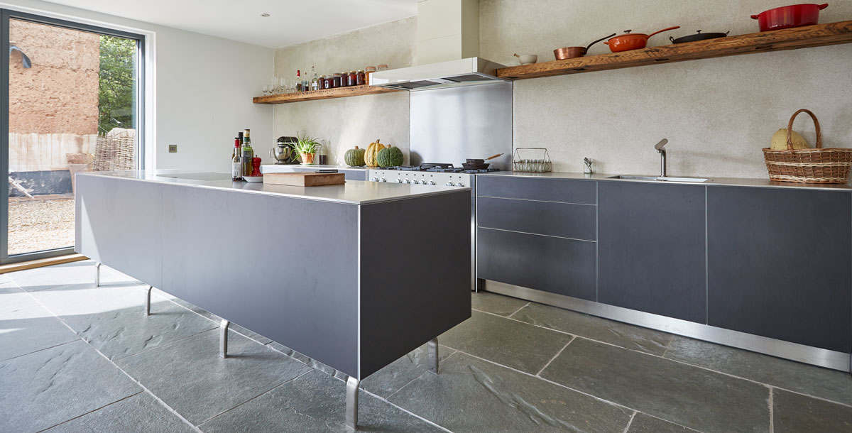 Kitchen with handleless mid-grey coloured units