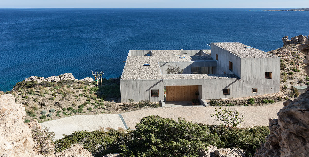 Concrete coastal home in Greece by OOAK Architects