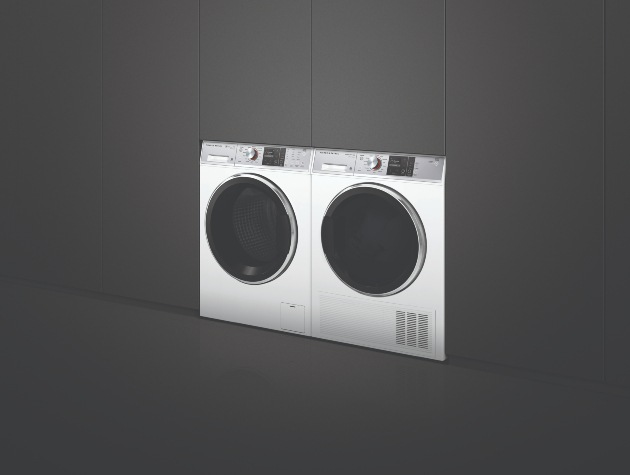 White Fisher Paykel washing machine and Heat Pump Dryer in a contemporary black interior
