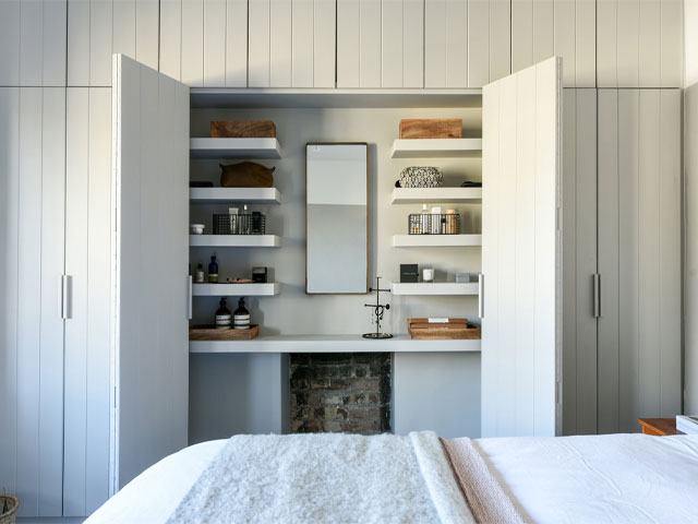Built-in wardrobes are a great way to use the alcoves beside a bedroom chimney breast for maximum storage