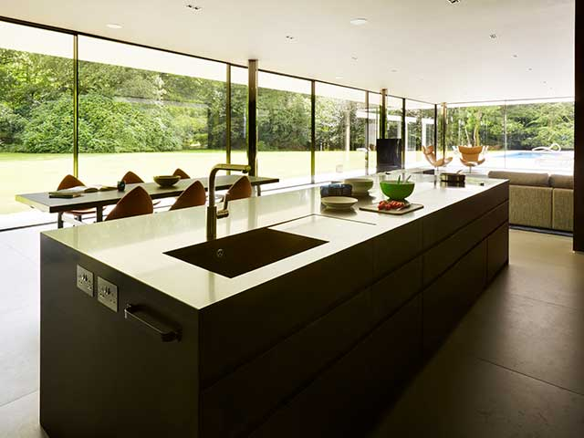 Kitchen island with gold taps and beautiful views of surrounding countryside