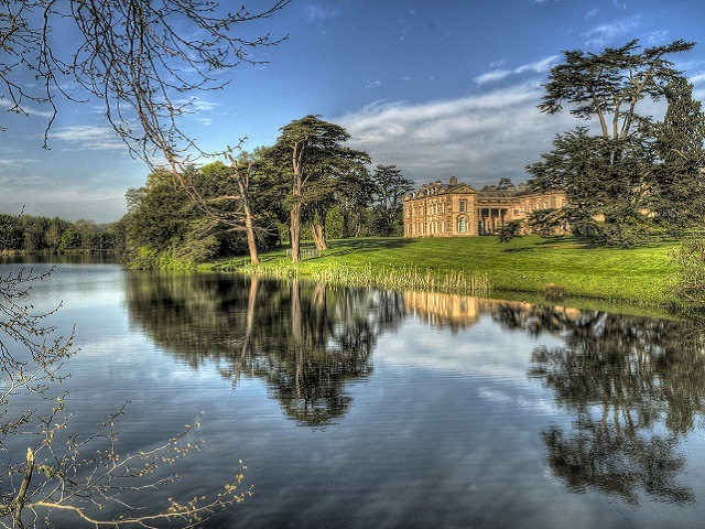 beautiful country manor in the English countryside next to a calm, still lake