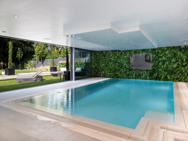 Luxury homes for sale in Buckinghamshire with indoor swimming pool and floor-to-ceiling bifold windows leading to the garden