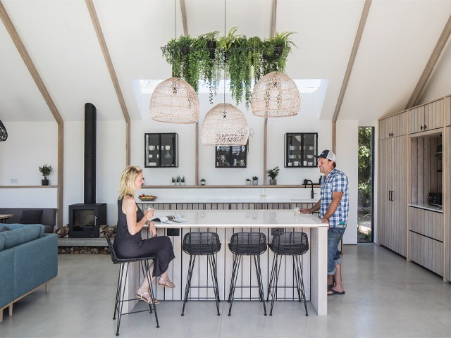 Inside the open plan kitchen diner of the Grand Designs swimming pond house in Chichester