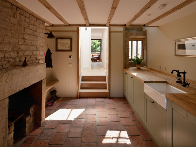 Inside the kitchen of the Grand Designs Scottish bothy with a view out to the formal garden