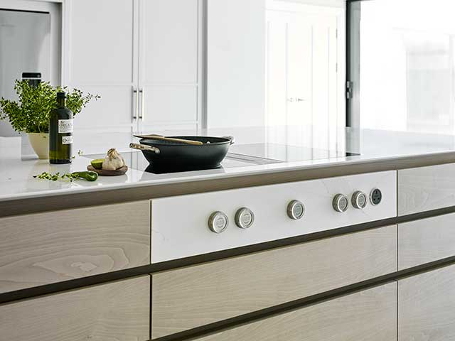kitchen island with cooking hob and storage drawers underneath