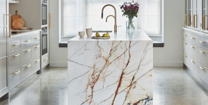 how to plan a kitchen island: this marble kitchen island was planned in at design stage